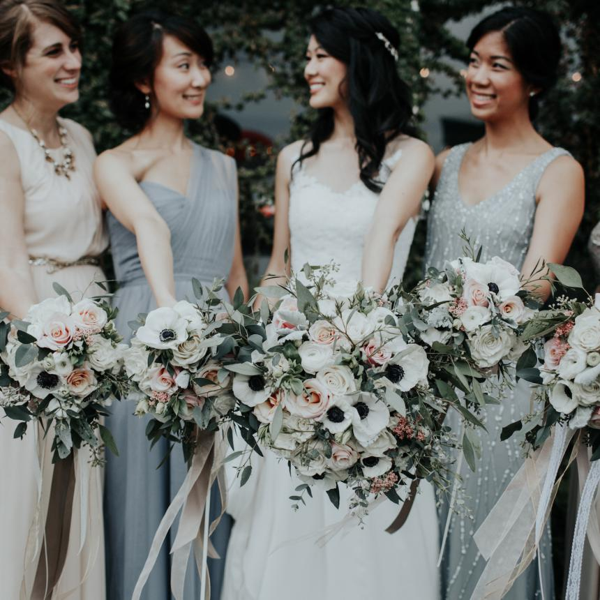 Grey Bridesmaids with White Poppy Bouquets