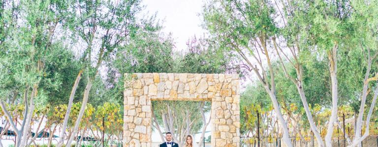 A couple standing under a stone arch